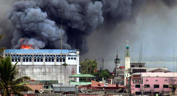 A building in Marawi, Philippines is set ablaze by airstrikes carried out by the Philippine Air Force