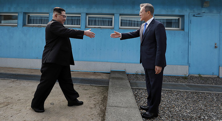 North Korean leader Kim Jong Un, left, prepares to shake hands with South Korean President Moon Jae-in