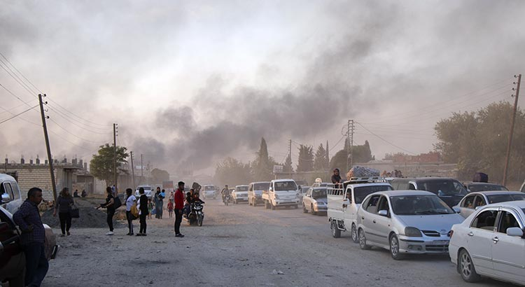 Syrians flee shelling by Turkish forces in Ras al Ayn, northeast Syria, Wednesday, Oct. 9, 2019