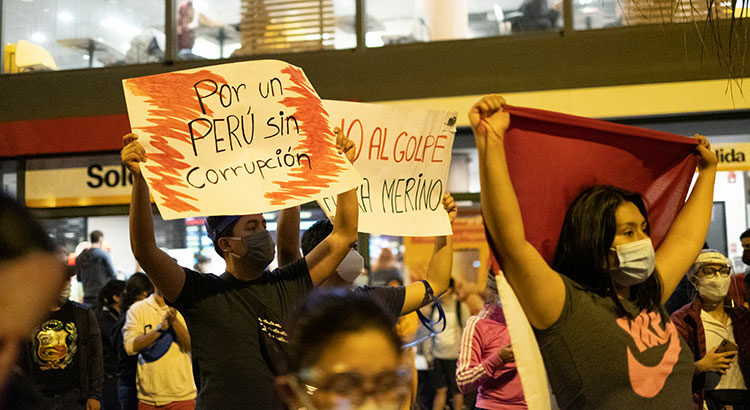 "Protesters in Miraflores demonstrate ""For a Peru without corruption"" on November 14, 2020. Peru's crisis ahead of the April 11 parliamentary elections is multifaceted. 