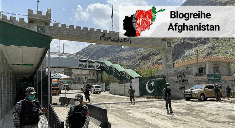 Security forces stand at the border of Pakistan and Afghanistan